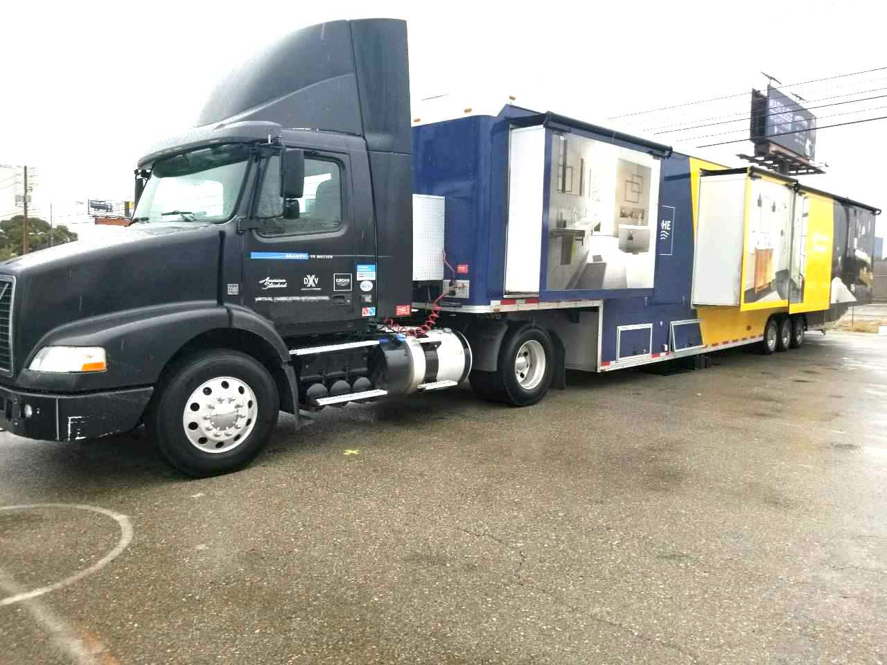custom marketing trailer with volvo tractor