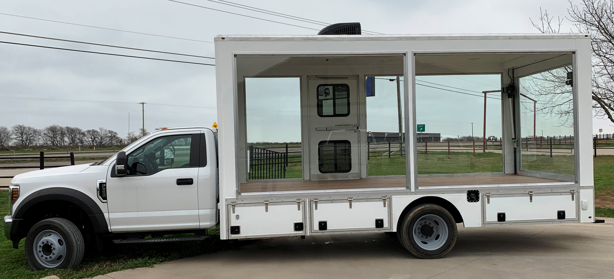 18' glass walled truck driver side
